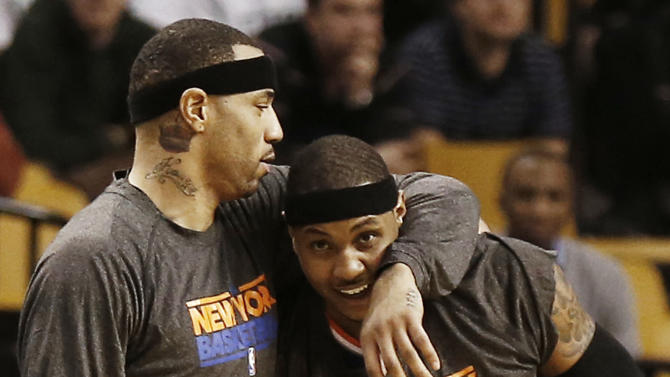 New York Knicks' Carmelo Anthony (7) gets a hug from teammate Kenyon Martin during the fourth quarter of New York's 90-76 win over the Boston Celtics in Game 3 of a first round NBA basketball playoff series in Boston Friday, April 26, 2013. (AP Photo/Winslow Townson)