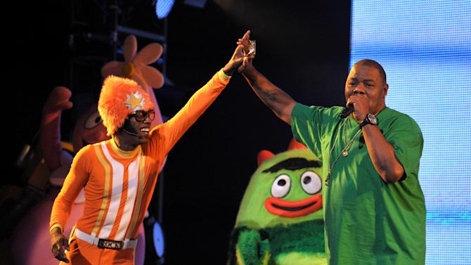DJ Lance Rock, left, and Biz Markie perform onstage at Yo Gabba Gabba! Live!: Get The Sillies Out! 50+ city tour kick-off performance on Thanksgiving weekend at Nokia Theatre L.A. Live on Friday Nov. 23, 2012 in Los Angeles. (Photo by John Shearer/Invision for GabbaCaDabra, LLC./AP Images)