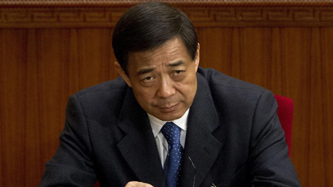 FILE - In this March 11, 2012 file photo, Chongqing party secretary Bo Xilai attends a plenary session of the National People's Congress at the Great Hall of the People in Beijing. Hours after Gu Kailai poisoned a British businessman, she reached out to a trusted ally: Wang Lijun. Gu was the wife of Bo Xilai and Wang was Bo's chief of police and longtime collaborator. According to an account released Wednesday, Sept. 19, 2012 by the government's Xinhua News Agency, when a panicked Gu turned to Wang for assistance following the murder, Wang helped her cover up the crime. (AP Photo/Andy Wong, File)
