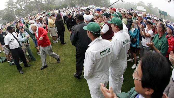Honorary starter Arnold Palmer walks to the first tee before the first round of the Masters golf tournament Thursday, April 11, 2013, in Augusta, Ga. (AP Photo/Charlie Riedel)
