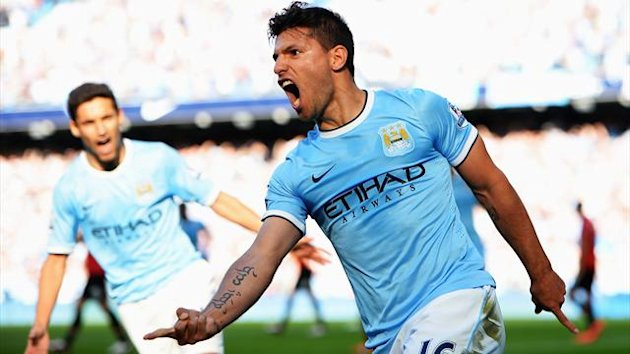 Sergio Aguero of Manchester City (16) celebrates as he scores their first goal during the Barclays Premier League match between Manchester City and Manchester United (Getty Images)
