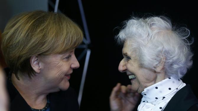 German Chancellor Merkel and Auschwitz survivor Fahidi attend the opening event for the international remembrance of the 70th anniversary of the Liberation of Auschwitz in Berlin