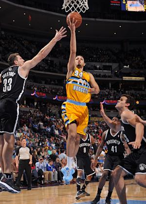 Nuggets beat Nets to win 18th straight at home