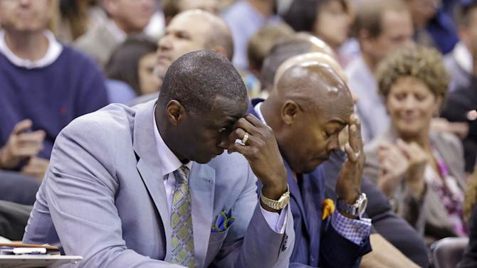 Utah Jazz's head coach Tyrone Corbin, left, lowers his head late in the fourth quarter during an NBA basketball game against the Los Angeles Lakers Monday, April 14, 2014, in Salt Lake City, Utah. The Lakers won 119-104