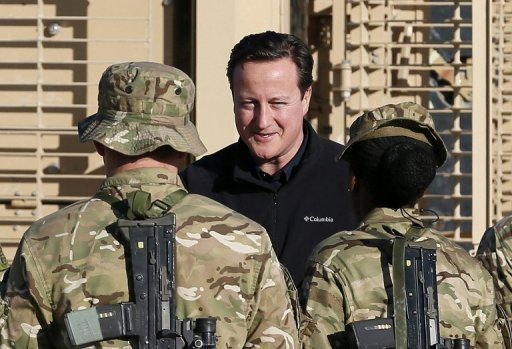 British Prime Minister David Cameron (C) visits Forward Operating Base Price in Helmand Province, Afghanistan, on Thursday. Cameron arrived in Oman on Friday as Britain's defence giant BAE Systems announced a £2.5 bn deal to supply fighter planes and trainer jets to the sultanate