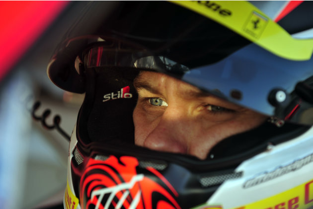 Risi Competizione Ferrari driver Toni Vilander, of Finland, waits in his car during warmup for the American Le Mans Series' Petit Le Mans auto race at Road Atlanta, Saturday, Oct. 1, 2011, in Braselto