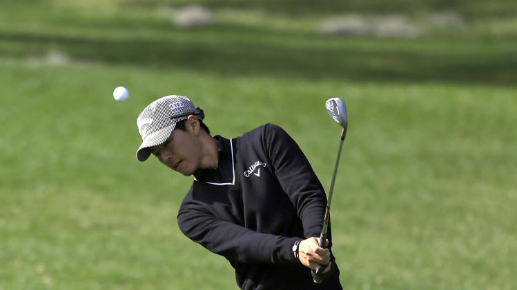 Ryo Ishikawa, of Japan, chips a shot to the first green during the first round of the Arnold Palmer Invitational golf tournament, Thursday, March 21, 2013, in Orlando, Fla. (AP Photo/John Raoux)