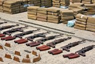 File photo of cocaine and weapons seized by Panamanian police are put on display in Panama City. A UNODC multimedia campaign will underline the huge sums of money involved in organised crime, which covers everything from drug and arms trafficking to cyber crime to the smuggling of migrants