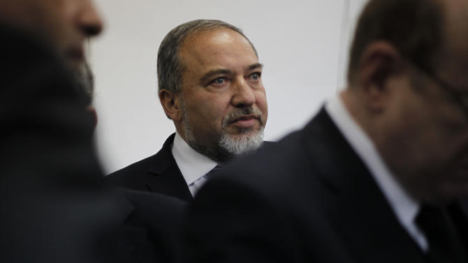 Israel's hard-line former Foreign Minister Avigdor Lieberman arrives at a Jerusalem court for the opening hearing of his trial on charges of fraud and breach of trust, Sunday, Feb. 17, 2013. Lieberman is accused of trying to advance the career of a former diplomat who relayed information to him about a since-closed criminal investigation into his business dealings. (AP Photo/Ariel Schalit)