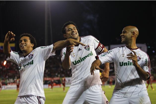 Fred of Brazil's Fluminense celebrates his goal against Venezuela's Caracas FC with his teammates during their Copa Libertadores soccer match in Caracas