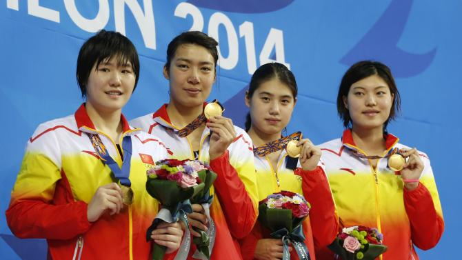 Gold medallists of China pose for photographers at the Women's 4x100m Freestyle Relay victory ceremony during the 17th Asian Games in Incheon