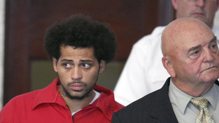 Carlos Ortiz, left, enters the Attleboro District Court with attorney John Connors, right, for his arraignment on weapons charges, Friday, June 28, 2013 in Attleboro, Mass. Ortiz was arrested Wednesday in Bristol, Conn., in connection with the murder case against former New England Patriots tight end Aaron Hernandez , now charged in the murder of Odin Lloyd. (AP Photo/The Boston Globe, George Rizer, Pool)