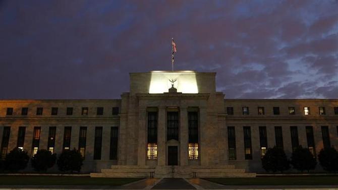 A general view of the U.S. Federal Reserve building as the morning sky breaks over Washington, July 31, 2013. REUTERS/Jonathan Ernst/Files