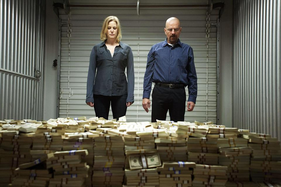 "This image released by AMC shows Skyler White, played by Anna Gunn, left, looking over a stash of money with her husband Walter White, played by Bryan Cranston, in season five of ""Breaking Bad."" The series finale of the popular drama series airs on Sunday, Sept. 29. (AP Photo/AMC, Lewis Jacobs)"