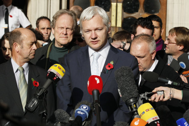 The founder of WikiLeaks Julian Assange, center, gives a statement to the media after his extradition hearing at the High Court in London, Wednesday, Nov. 2, 2011. Assange on Wednesday lost his appeal
