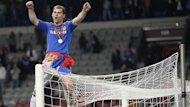 Chelsea&#39;s Branislav Ivanovic sits on a goalpost after they defeated Benfica in the Europa League final (Reuters)