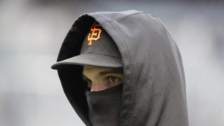 San Francisco Giants' Ryan Theriot is bundled up during batting practice before Game 4 of baseball's World Series against the Detroit Tigers Sunday, Oct. 28, 2012, in Detroit. (AP Photo/David J. Phillip)