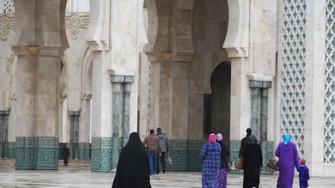 This January 2013 photo shows women about to enter Casablanca's monumental Hassan II mosque in Morocco. Many Moroccan women wear the traditional djellaba, or hooded tunic. (AP Photo/Giovanna Dell'Orto)