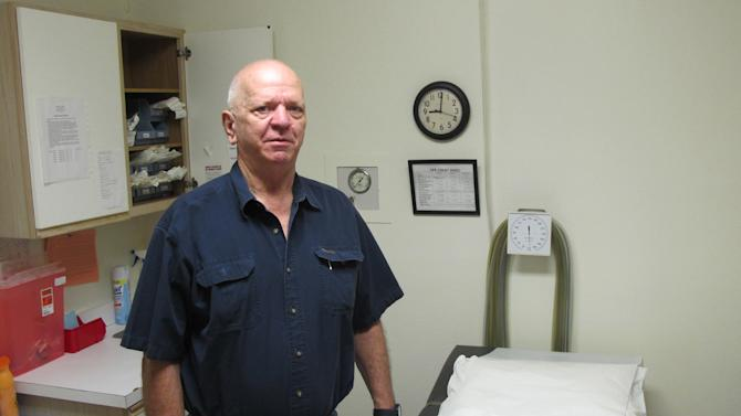 Dr. Lester Minto stands inside one of the rooms where he has performed abortions for years at the Reproductive Services clinic in Harlingen, Texas, on Friday, Nov. 1, 2013. A third of the abortion clinics in Texas can no longer perform the procedure starting Friday after a federal appeals court allowed most of the state's new abortion restrictions to take effect. Minto continued to see patients Friday for their initial consultation with the hope that legal action will make it possible to perform his patients' abortions on Saturday. (AP Photo/Chris Sherman)