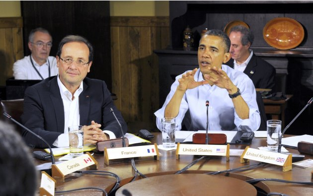 French President Francois Hollande, left, listens as U.S. President Barack Obama speaks at the start of the first working session of the G8 Summit at Camp David, Md., Saturday May 19, 2012. (AP Photo/