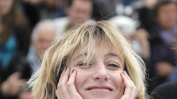 Director Valeria Bruni Tedeschi poses for photographers during a photo call for the film Un Chateau en Italie at the 66th international film festival, in Cannes, southern France, Tuesday, May 21, 2013. (AP Photo/Francois Mori)