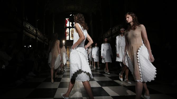 Models present creations from the Simone Rocha Spring/Summer 2015 collection during London Fashion Week