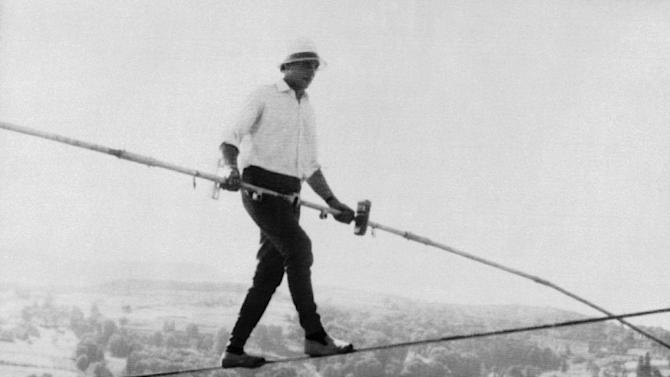 FILE - French tightrope walker Henri Rechatin walks over the Saint-Remy sur Durolle countryside in central France, in this July 16, 1967 file photo, as he breaks the specialty's world record of the time. The celebrated French tightrope walker known as Henry's, who balanced above high the Alps, the Grand Canyon and Niagara Falls, has died Friday Dec. 27 2013, aged 82, the mayor of his home town of St Etienne announced Saturday. (AP Photo, File)