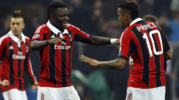 AC Milan's Sulley Muntari (L) celebrates with teammate Kevin-Prince Boateng after scoring against Barcelona (Reuters)