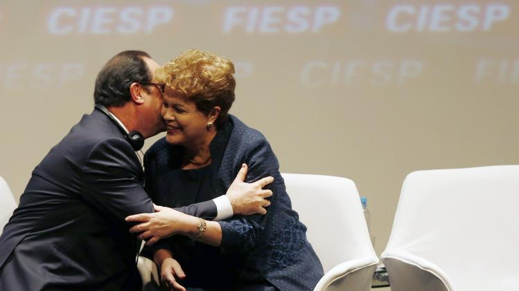France's President Hollande is greeted by Brazil's President Rousseff during a meeting in Sao Paulo