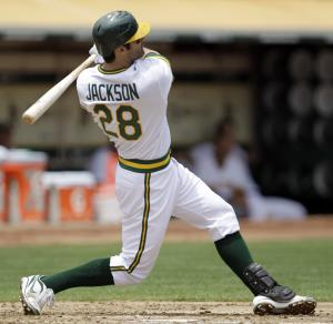 Oakland Athletics' Conor Jackson hits a grand slam off Los Angeles Angels' Joel Pineiro in the first inning Sunday, July 17, 2011, in Oakland, Calif. (AP Photo/Ben Margot)