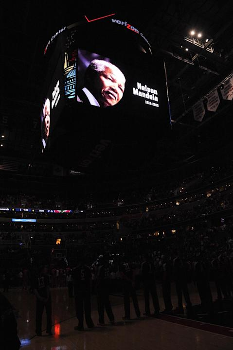 An image of  former South African President Nelson Mandela, who died Thursday, is displayed on the scoreboard before an NBA basketball game between the Washington Wizards and the Milwaukee Bucks, Frid