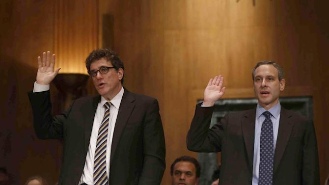 Ousted IRS Chief Steve Miller, left, and former IRS Commissioner Douglas Shulman are sworn in  on Capitol Hill in Washington, Tuesday, May 21, 2013, prior to testifying before the Senate Finance Committee hearing on the Internal Revenue Service (IRS) practice of targeting applicants for tax-exempt status based on political leanings. (AP Photo/Charles Dharapak)