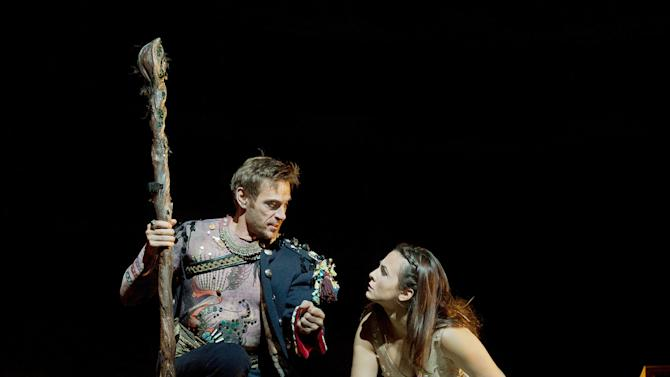 """In this Oct. 15, 2012 photo provided by the Metropolitan Opera, Simon Keenlyside is Prospero and Isabel Leonard is Miranda during a dress rehearsal of Thomas Adès's """"The Tempest,"""" at the Metropolitan Opera in New York. (AP Photo/Metropolitan Opera, Ken Howard)"""