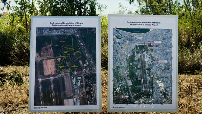 Maps of the area contaminated with dioxin around Danang airport are displayed during a ceremony marking the start of a project to clean up dioxin left over from the Vietnam War, at a former U.S. military base in Danang, Vietnam Thursday Aug. 9, 2012. The U.S. and Vietnam on Thursday launched a four-year joint effort to clean up dioxin leftover from Agent Orange that was mixed, stored and loaded onto planes at the former U.S. military base, which is now part of Danang's airport. Dioxin can linger in soils and at the bottom of lakes and rivers for generations, entering the food supply through the fat of fish and other animals. (AP Photo/Maika Elan)