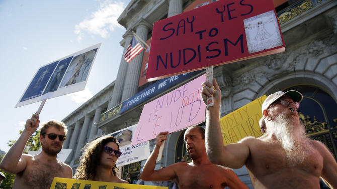 Demonstrators gather at a protest against a proposed nudity ban outside of City Hall in San Francisco, Wednesday,  Nov. 14, 2012.  San Francisco appears poised to shed part of its image as a city where anything goes, including clothing. The Board of Supervisors is scheduled to vote next week on a law that would ban public nudity. The proposal comes in response to a devoted group of nudists who proudly strut their stuff through the city's Castro District. (AP Photo/Marcio Jose Sanchez)
