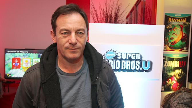 Actor Jason Isaacs warms up and checks out Wii U at the Nintendo Lounge during a break from the Sundance Film Festival on Saturday, January 20, 2013 in Park City, UT. (Photo by Donald Traill/Invision for Nintendo/AP Images)