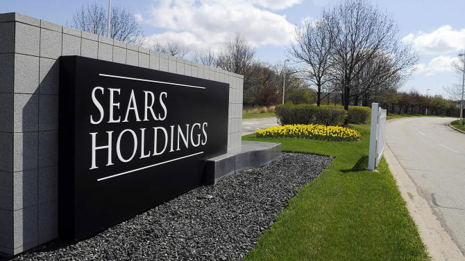 """FILE - This May 4, 2011 file photo shows the entrance to the Sears Holdings Corp. Prairie Stone campus area in Hoffman Estates, Ill. Sears Holding Corp. spokesman Chris Brathwaite told Crain's Chicago Business the company is laying off """"about 100 people"""" Thursday, Feb. 16, 2012, at its headquarters in Hoffman Estates. He says the layoffs take effect immediately. (AP Photo/Daily Herald, Mark Welsh, File)  MANDATORY CREDIT, MAGS OUT, TV OUT"""