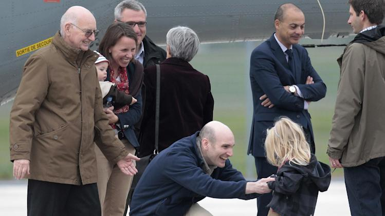 """FILE -This April 20, 2014 photo from files shows released French hostage Nicolas Henin, center, meeting his daughter upon his arrival at the Villacoublay military airbase, outside Paris. French freelance journalist Nicolas Henin told the Associated press he spent seven months with James Foley, from October 2013 to April 2014. """"We shared the same cell, including during our transfer from one place to another, we were transferred together,"""" Henin said. (AP Photo/Jacques Brinon, File)"""