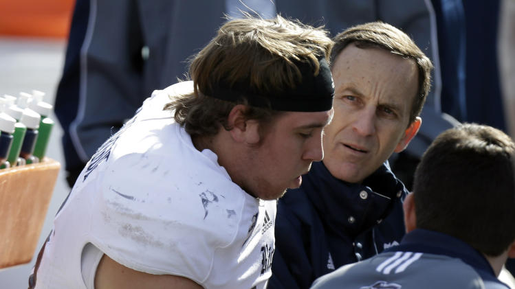 Rice quarterback Taylor McHargue is checked on the bench after he left the game with a concussion during the first half of the Armed Forces Bowl NCAA college football game against Air Force, Saturday, Dec. 29, 2012, in Fort Worth, Texas.  (AP Photo/LM Otero)