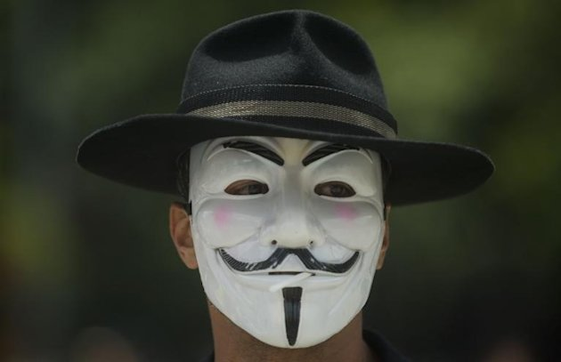 Illustration: hackers from Anonymous, who often wear Guy Fawkes masks similar to the one pictured when making public statements, said they had targeted Australian websites to protest reports of spying on Indonesia