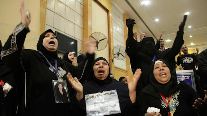 Families of the victims of the Ultras Al-Ahli, football supporters react in court with joy after the issuance of the death penalty for 21 accused in last years Port Said football violence, in Cairo, Egypt, Saturday, Jan. 26, 2013. Egyptian security officials say a senior police officer and a policeman were shot dead in the Mediterranean city of Port Said after a judge sentenced 21 people to death in connection to one of the world's deadliest incidents of soccer violence. (AP Photo/Ahmed Abd El-Latef, Shorouk Newspaper)   EGYPT OUT
