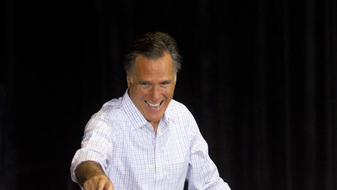 Republican presidential candidate and former Massachusetts Gov. Mitt Romney waves to supporters before he makes a speech in Miami, Wednesday, Sept. 19, 2012. (AP Photo/J Pat Carter)