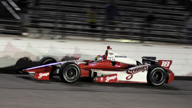 Justin Wilson (18), of England, comes out of Turn 4 during the IZOD IndyCar Firestone 550 auto race at Texas Motor Speedway, Saturday, June 9, 2012, in Fort Worth, Texas. Wilson won the race. (AP Photo/Larry Papke)