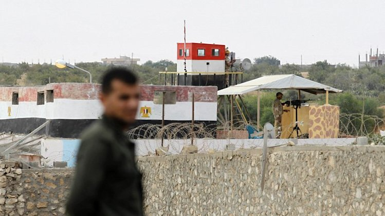 A Hamas policeman (L) stands in Rafah in the southern Gaza Strip on the border with Egypt, on July 8, 2013
