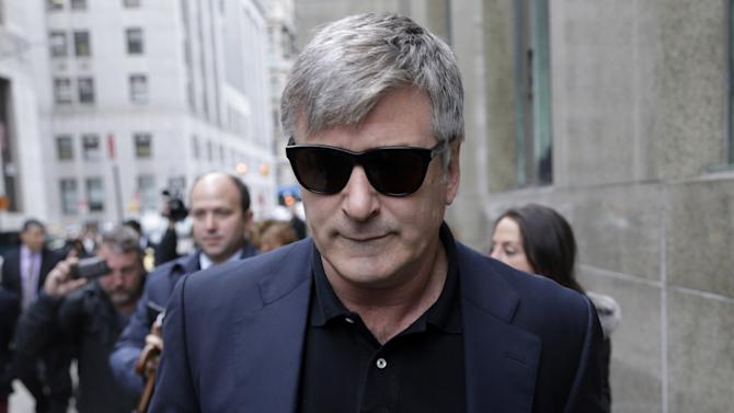 Actor Alec Baldwin leaves criminal court in New York, Tuesday, Nov. 12, 2013. Baldwin testified Tuesday that he never had a sexual or romantic relationship with Canadian actress Genevieve Sabourin, who is accused of stalking him. He said that after they met she began leaving dozens of voice mails for him a night and eventually started threatening to show up at his homes. (AP Photo/Seth Wenig)