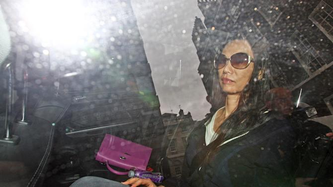 Wendi Murdoch wife of News Corporation Chairman and CEO Rupert Murdoch, arrives home in central London early Monday, July 18, 2011. The phone hacking and police bribery scandal cut closer than ever to Rupert Murdoch and Scotland Yard with the arrest of his former British newspaper chief and the resignation of London's police commissioner, raising the possibility that more of the media mogul's top aides could fall. (AP Photo/Steve Parsons/PA)UNITED KINGDOM OUT - NO SALES - NO ARCHIVES