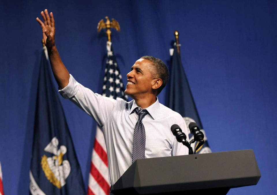 President Barack Obama waves as he arrives to speak at a fundraiser at The House of Blues in New Orleans, Wednesday, July 25, 2012. (AP Photo/Gerald Herbert)