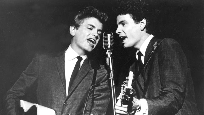 FILE - This July 31, 1964 file photo shows The Everly Brothers, Don and Phil, performing on stage. Everly, who with his brother Don formed an influential harmony duo that touched the hearts and sparked the imaginations of rock 'n' roll singers for decades, including the Beatles and Bob Dylan, died Friday, Jan. 3, 2014. He was 74. Everly died of chronic obstructive pulmonary disease at a Burbank hospital, said his son Jason Everly. (AP Photo, File)