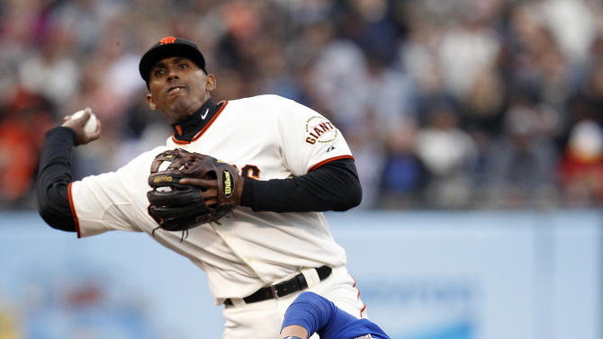 San Francisco Giants third baseman Joaquin Arias, top, gets the force out on Chicago Cubs' Darwin Barney during the fifth inning of a baseball game on Saturday, July 27, 2013, in San Francisco. (AP Photo/Tony Avelar)