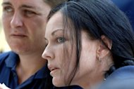 Convicted Australian drug trafficker Schapelle Corby (R), pictured in 2008, will be released by Indonesia in September 2017, a prison chief said Friday, after she had five years slashed off her 20-year term
